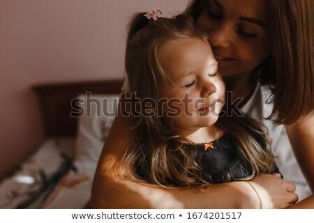 Iki öpücük anne küçük stüdyo beyaz Stok fotoğraf © RuslanOmega
