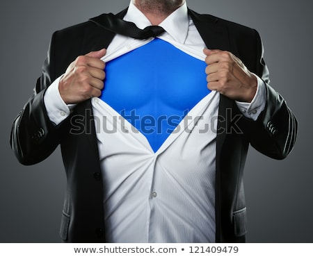 Businessman acting like a super hero Stock photo © alphaspirit