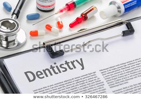 Dentistry written on a clipboard Stock photo © Zerbor