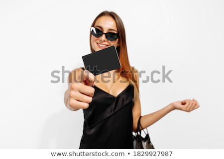 black friday woman with business card discounts stock photo © studiostoks