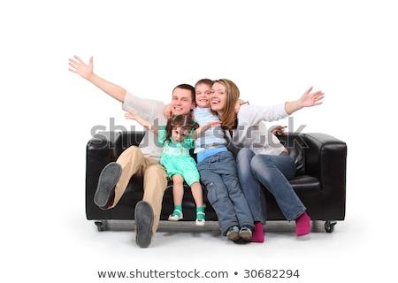 pais · crianças · sentar-se · preto · couro · sofá - foto stock © Paha_L