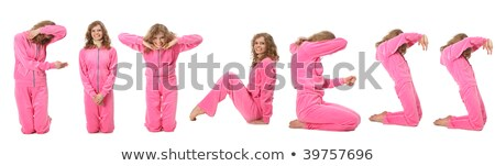 Girl in pink sport clothes represents word FITNESS Stock photo © Paha_L