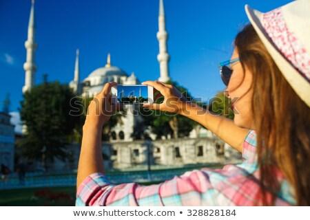Stockfoto: Meisje · hoed · foto · smartphone · Blauw