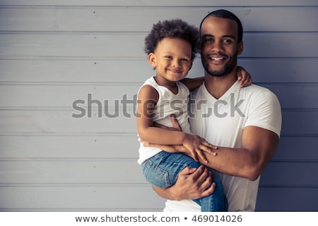 Smiling afro american man looking at camera Stock photo © deandrobot
