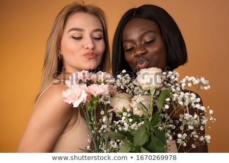 close up of happy lesbian couple with flowers stock photo © dolgachov
