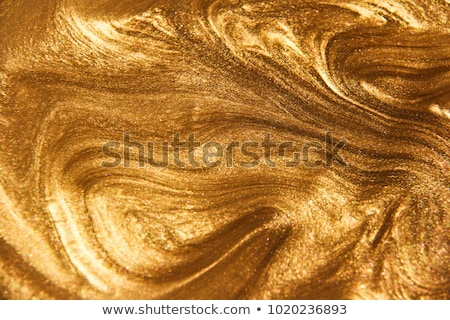 Liquid gold stock photo © alex_l