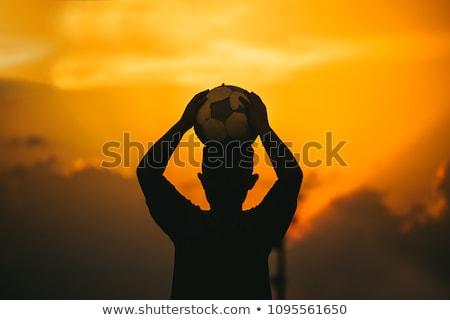 Jovem meninos jogar jogo de futebol pôr do sol sol Foto stock © smuki