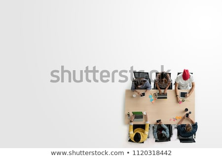 Top view of student sitting at wooden table and working with tab Stock photo © adam121
