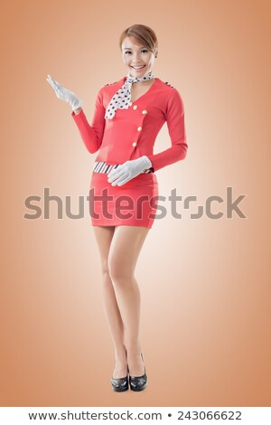 Beautiful smiling flight attendant in uniform presenting and showing ok sign gesture. Vector illustr Stock photo © maia3000