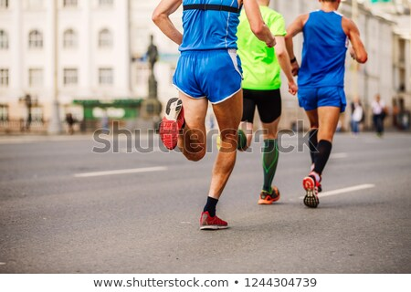 Marathon courir course trois coureurs ville Photo stock © smuki