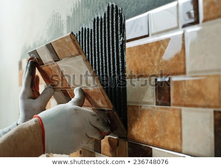 Stock foto: Repair Work Laying Tiles On The Wall