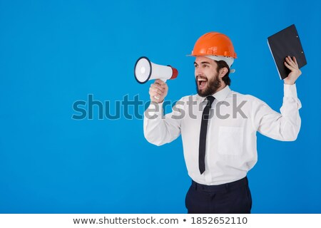 young construction worker with loudspeaker isolated on white stock photo © elnur