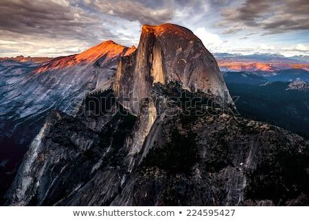 Fél kupola Yosemite Nemzeti Park égbolt erdő naplemente Stock fotó © pedrosala