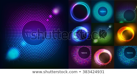 colorful glossy glowing rings on black background stock photo © saicle