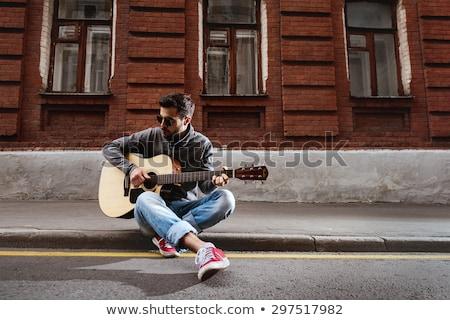 Confident male singer playing guitar Stock photo © wavebreak_media
