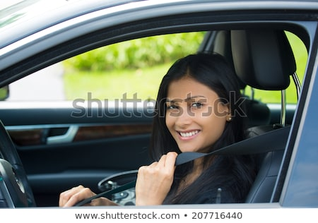Car safety concept. Woman driver fastening seat belt, smiling  Stock photo © ichiosea