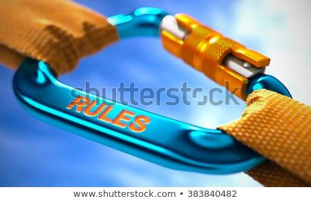 Rules on Blue Carabiner between Orange Ropes. Stock photo © tashatuvango