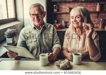 Elderly man using tablet and drinking coffee Stock photo © wavebreak_media