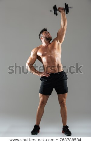 shirtless man lifting heavy dumbbell stock photo © wavebreak_media
