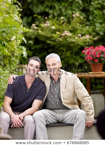 Two men sitting in patio facing camera Stock photo © IS2