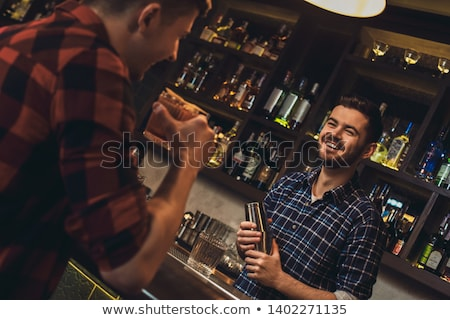 Male bartender talking to customers Stock photo © IS2