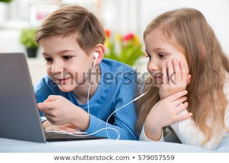 Boldog kislány játszik laptop hallgat zene Stock fotó © goce