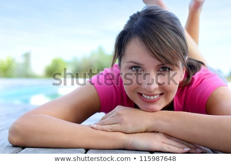Woman laying down on a deck Stock photo © IS2