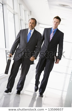 Stock photo: Two Middle Eastern businessmen holding briefcases