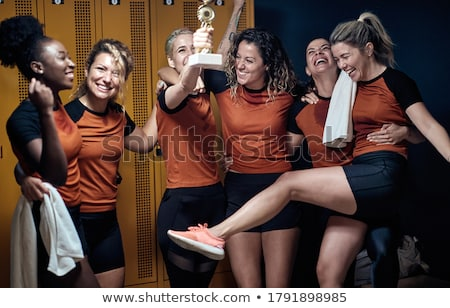 woman standing in gym locker room after workout stock photo © wavebreak_media