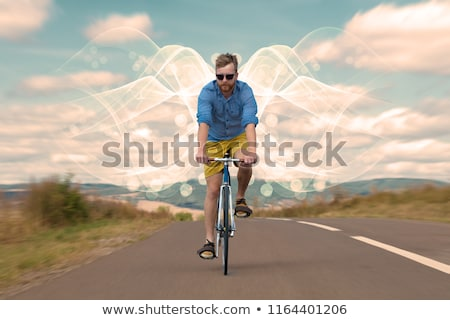 Fashion cyclist in the nature going somewhere Stock photo © ra2studio