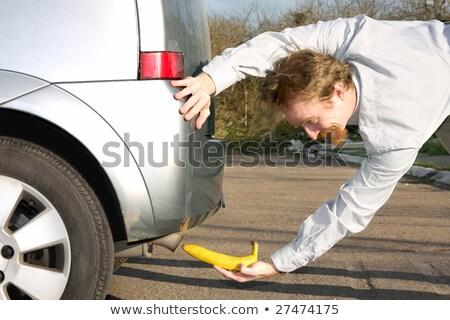Férfi banán autó kipufogó cső város Stock fotó © vladacanon