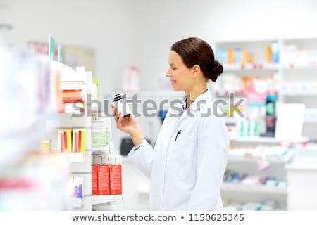 Feliz feminino droga farmácia medicina saúde Foto stock © dolgachov