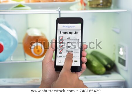 Main humaine Shopping liste alimentaire Photo stock © AndreyPopov