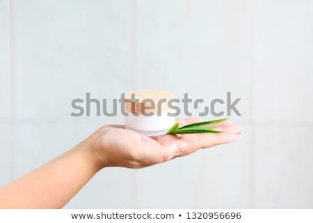 Mulher verde bambu folhas mão Foto stock © dashapetrenko