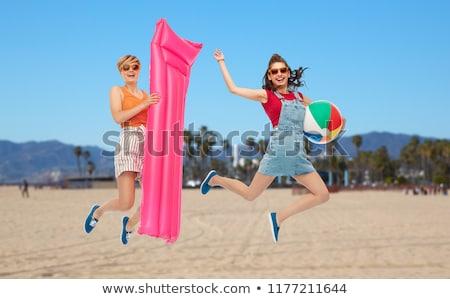Saltando bola de praia colchão verão férias Foto stock © dolgachov
