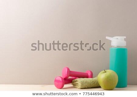 Fitness concept. Dumbbells, water bottle and apple Stock photo © karandaev