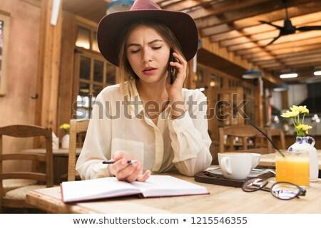 Stockfoto: Verward · meisje · hoed · vergadering · cafe