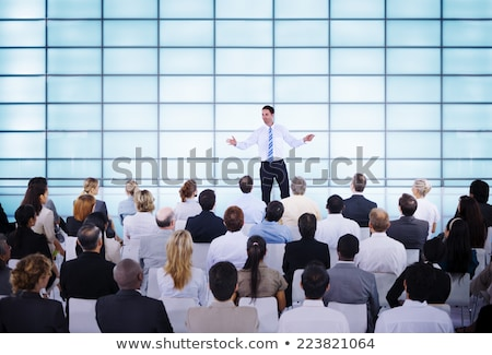 an african businessman giving presentation to his colleagues stock photo © andreypopov