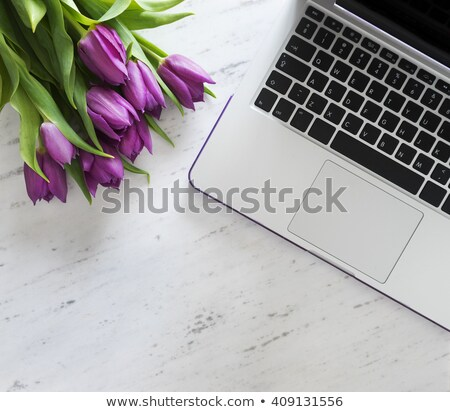 Stock photo: Laptop on white floor with flowers. tulips