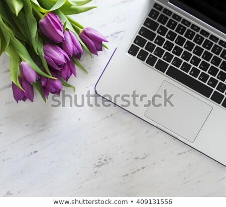 laptop on white floor with flowers tulips stock photo © elenabatkova