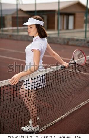 Jonge witte permanente net tennisbaan Stockfoto © pressmaster