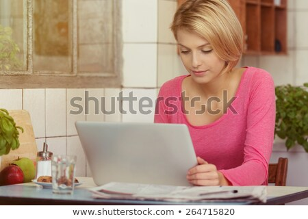 Pretty student concentrating on reading online information Stock photo © pressmaster