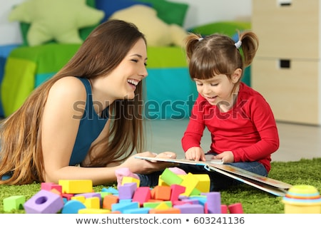 Happy Motherhood, Lady Reading Book to Young Girl Stock photo © robuart
