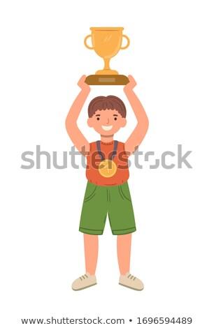 smiling winner holding award over head vector stock photo © robuart