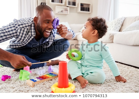 boy and other children playing at home Stock photo © dolgachov
