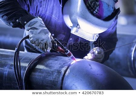 Trabalhador soldagem tubo oficina industrial soldador Foto stock © lichtmeister