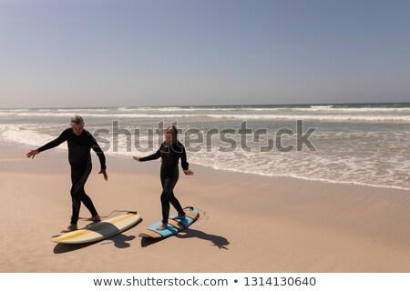 Vista laterale attivo senior surfer Coppia piedi Foto d'archivio © wavebreak_media