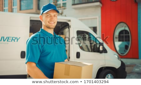Smiling Male Mover Loading The Cardboard Boxes In Van Stock photo © AndreyPopov