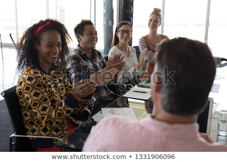 Side view of young multi-ethnic business colleagues applauding businessman in modern office Stock photo © wavebreak_media