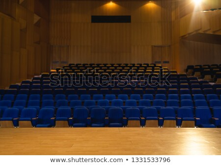 Empty auditorium with all lights on with blue chair around Stock photo © wavebreak_media